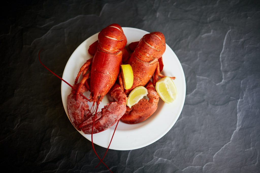 Two lobsters on a place